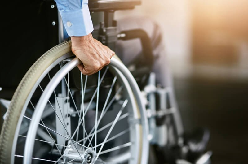 person in wheelchair - disability insurance protection - insurance planning services farmington ct