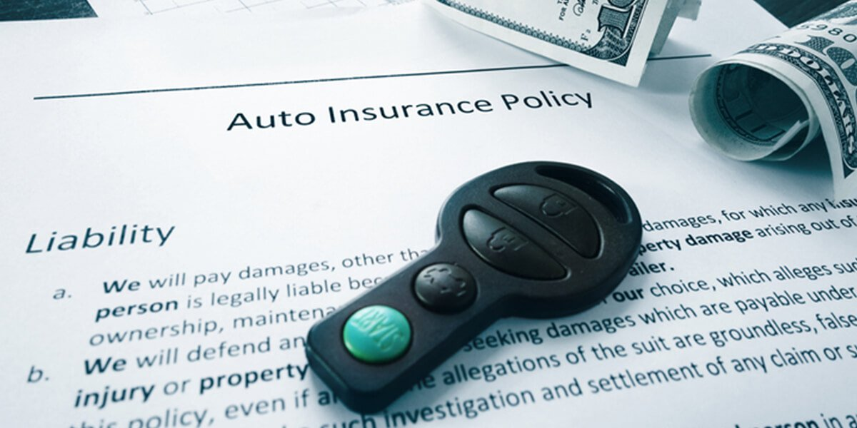 key and cash on auto insurance policy papers - we provide insurance planning services farmington ct