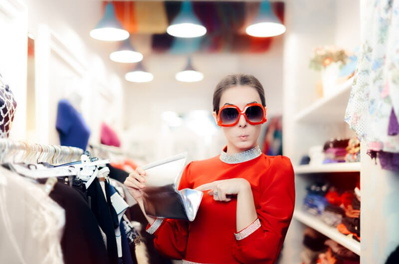woman shopping with sunglasses - change spending habits - financial planning services farmington c