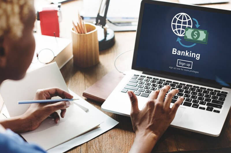bank signup on laptop - how to choose a bank - financial planning services farmington ct