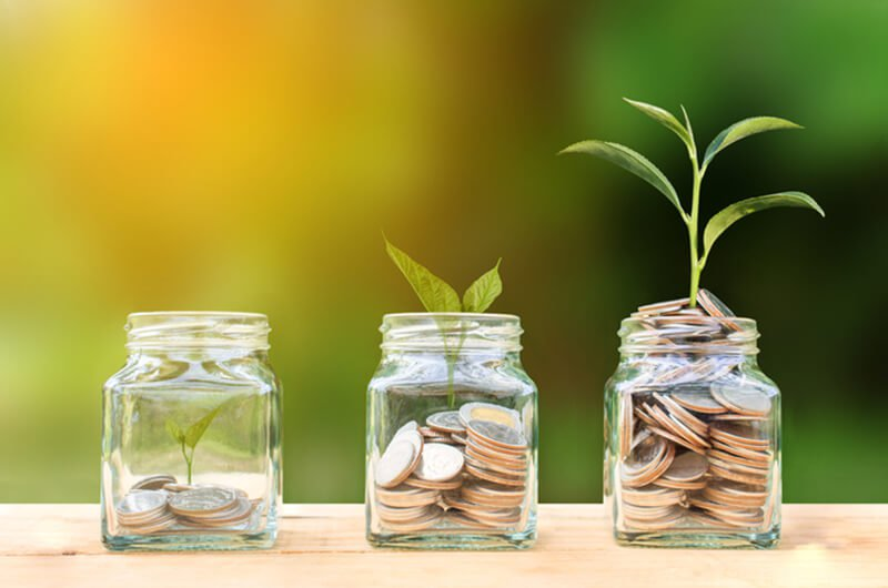 coins growing in jars conceptual - best rated wealth planning planning services in farmington CT