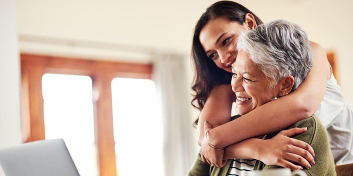 adult child holding parent - best rated financial planning services farmington ct