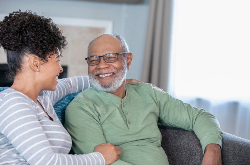 woman visiting father - best rated financial retirement planning services in farmington CT
