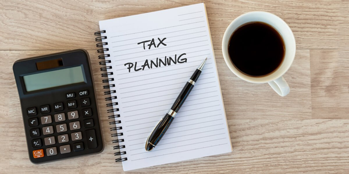 tax planning text on notepad - protect estate from taxes - financial planning services farmington