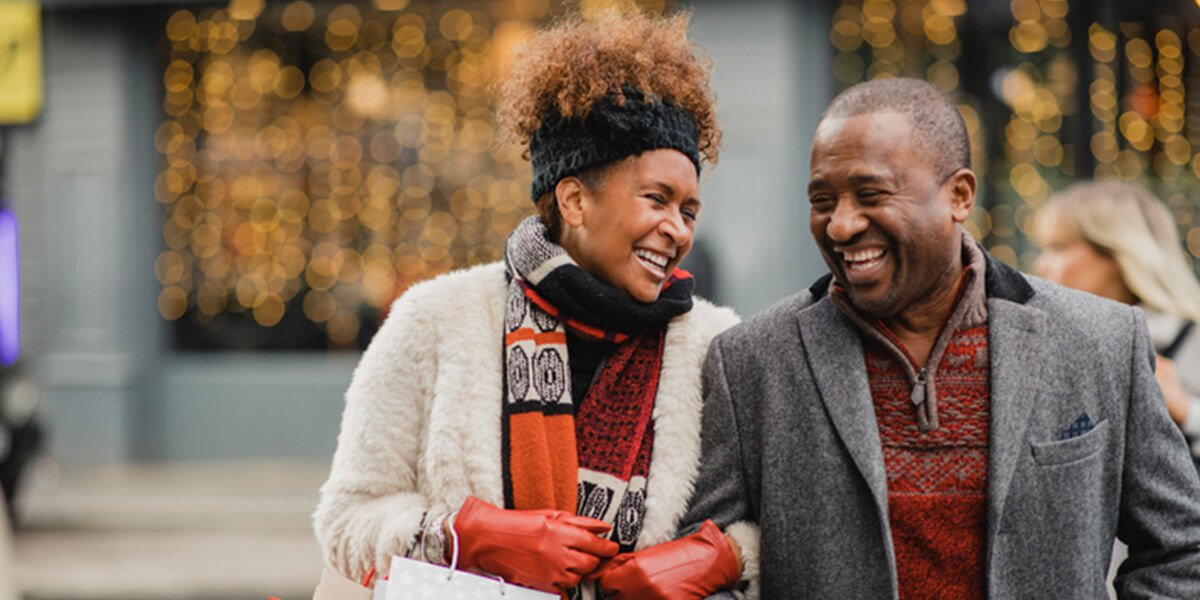 happy black couple outdoors - retirement planning and budgeting services in farmington CT
