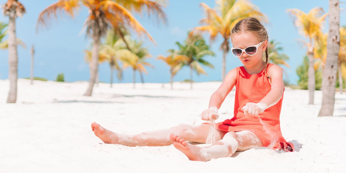 girl on tropical beach - vacation financial protection planning services farmington ct