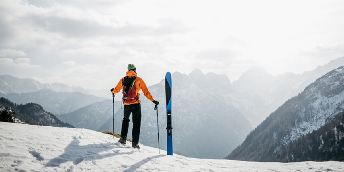 skier top of mountain looking - we provide insurance planning services farmington ct